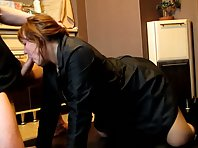 Sexy redhead giving her man head in the kitchen while wearing a raincoat