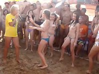 Topless babes hosed down and groped at beach party